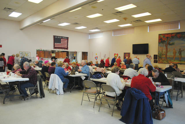 Whitney Vickers | Greene County News The Fairborn Senior Center hosted a special lunch Feb. 15 in the spirit of Valentine's Day. Menu items highlighted surf and turf options, complete with steak, shrimp, salad, bread, a baked potato and strawberry shortcake for dessert.