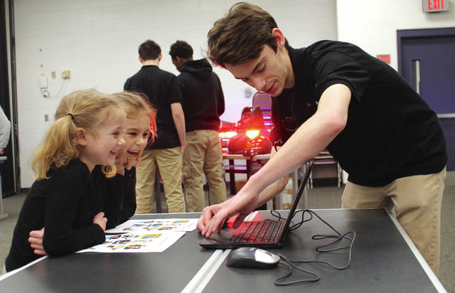 Anna Bolton | Greene County News Yellow Springs' Mills Lawn Elementary kindergartners participated in hands-on career day activities March 20 at Greene County Career Center. High school juniors and seniors introduced different career technical programs to the children, who happily played along.