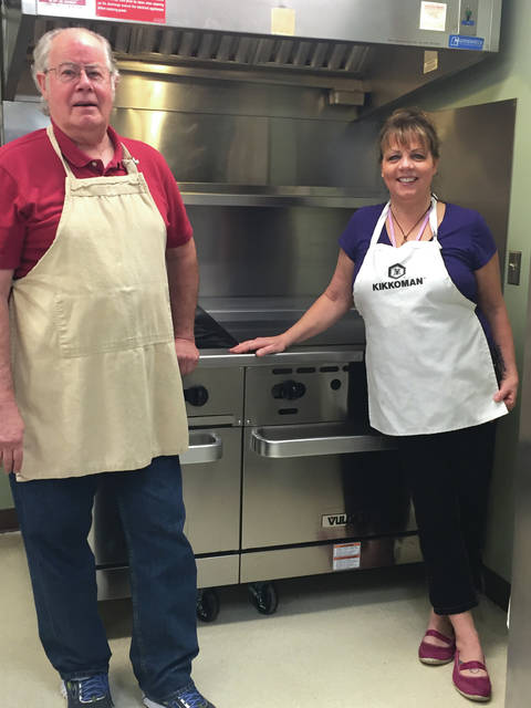 Submitted photo Proceeds from last year's Denim & Diamonds helped fund a new stove and dishwasher for Family Violence Prevention Center's kitchen. Kitchen volunteers like Jim Rigney and Kitchen Coordinator Debbie Tipton use the appliances daily.