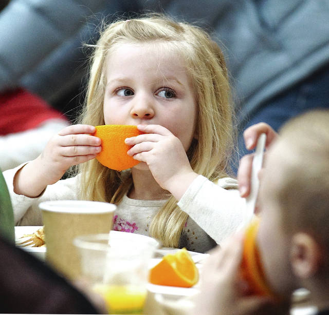 Barb Slone   Greene County News Greene County Parks & Trails volunteers served oranges, pancakes, maple syrup and more to families March 3 at GCP&T Annual Maple Sugar Pancake Breakfast at Bellbrook Middle School.