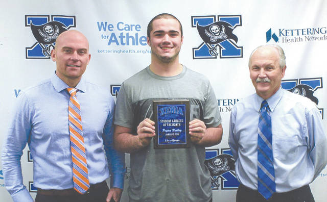 Peyton Bartley was chosen as the Edward Jones Investments Athlete of the Month for January for Xenia High School. This award is being sponsored by the office of Mike Reed at Edward Jones Investments of Xenia, serving Xenia, Jamestown, Cedarville and surrounding areas. Bartley (center) with XHS Athletic Director Nathan Kopp, left, and Reed, is a junior on the wrestling team, football team and track and field. He is the epitome of a student-athlete. He works hard on and off the field, continuously striving to better himself in athletics. His participation in clubs and school activities rounds out his active high school career. Peyton is always willing to go above and beyond to be successful.