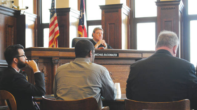 Whitney Vickers | Greene County News Defense Attorney John Leahy, Defendent Anthony Moore and Defense Attorney Adrian King. Judge Michael Buckwalter is pictured in the background.