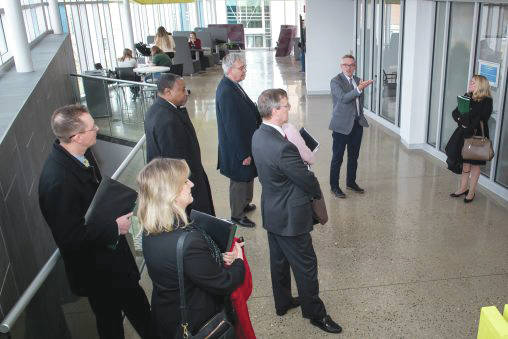 Tim Littell, center, executive director of student success and associate dean, led a tour of the Student Success Center.