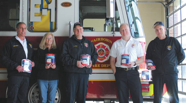 Whitney Vickers | Greene County News The Dayton Firefighters Federal Credit Union is donating a total of 450 carbon monoxide detectors to eight local fire departments, including the Fairborn Fire Department.