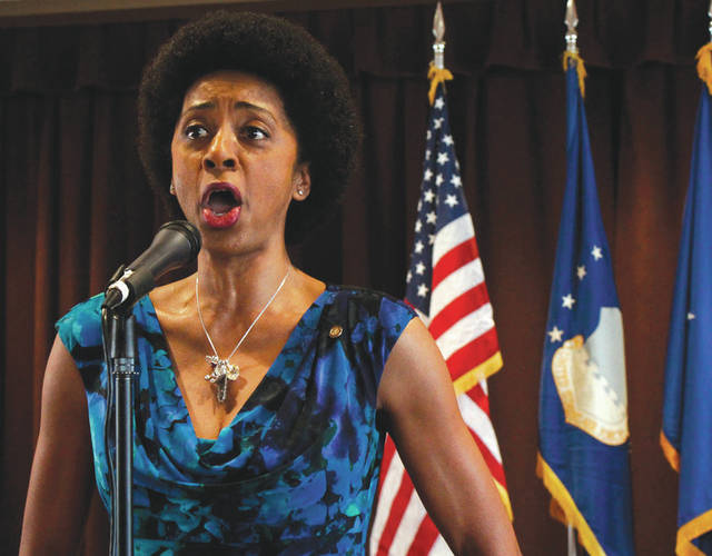 Submitted photo Retired Tech. Sgt. Felita LaRock sinings the National Anthem at the start of the Air Force Security Assistance and Cooperation Directorate's 22 Annual Black History Month Luncheon.