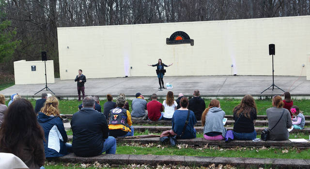Leah Fay, FVPC sexual assault response coordinator, speaks to a crowd in the amphitheater.