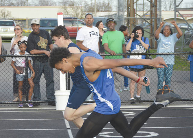 The anchor leg runners for the Xenia and Fairborn boys 800-meter relay teams finished in a photo finish in the first heat, April 13 at the inaugural Doug Adams High School Invitational track and field meet in Xenia. Fairborn (far lane) finished second overall .01 of a second ahead of third-place Xenia.