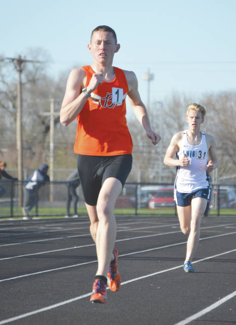 Beavercreek's Riley Buchholz (front) and Legacy Christian Academy's Isaac Erlundson, shown here while competing together at the Greene County Invitational earlier this season, each qualified to the 2018 state track and field championships, June 1-2 in Columbus. Buchholz advanced in Division I in the 800-meter run; Erlundson will compete in the Division III 1,600-meter run.