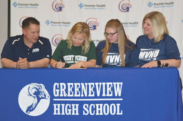 Greeneview senior Grace Nolen (second from left) recently signed a national letter of intent to play women's college soccer at Mount Vernon (Ohio) Nazarene University. Nolen was a four-year varsity player for the Rams and was a team captain for her senior year. She received the Greeneview Sportsmanship Award all four years as well. Joining Nolen at the table are her father, Tom Nolen (far left), sister Darby, and mother, Karen. MVNU is an NAIA Division II program that has been ranked nationally in three of the past four years. The Cougars play in the Crossroads League.