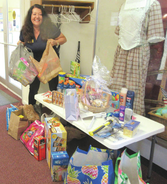 Submitted photo Mia Walthers with items collected for the USO from the Rebecca Galloway Chapter DAR.