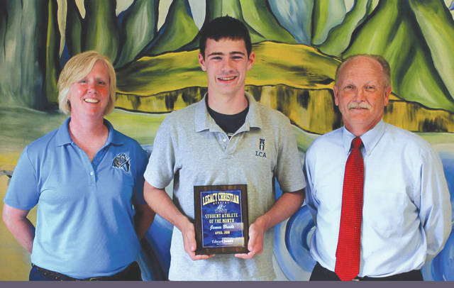 James Brads (shown with Athletic Director Bev Moser, and Mike Reed) was chosen as the Edward Jones Investments Athlete of the Month for April for Legacy Christian Academy School. This award is being sponsored by the office of Mike Reed at Edward Jones Investments of Xenia, serving Xenia, Jamestown, Cedarville and surrounding areas. Brads ran cross country, played basketball and ran track. He set a new school record in the 800-meter run, and was a first team all-Metro Buckeye Conference selection for cross country and track. His grade is a 4.0.