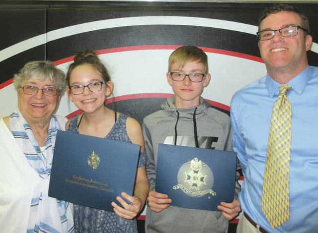 Submitted photo The Rebecca Galloway Chapter DAR and the George Rogers Clark Chapter SAR recently awarded Youth Citizenship Awards to two Greenon eighth graders students at their annual awards ceremony May 9. Braelynn Cameron and Bryan Murphy were selected by their teachers for their dependability in and out of the classroom, their service and leadership and overall patriotism, all to an outstanding degree. Pictured from left to right are Barbara Arnold - DAR Representative, Braelynn Cameron, Bryan Murphy and Tom Jenkins - SAR Representative.