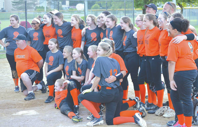 Members of the Beavercreek Fastpitch Association's two U14 girls softball teams pose for a group photo after Wednesday's June 6 season opening game at Rotary Park.