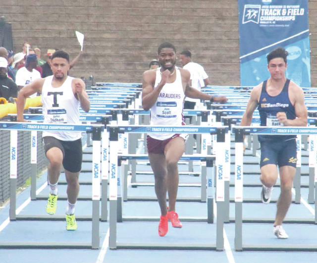 Central State University sophomore Juan Scott (center) was named Male Athlete of the Year by HBCU Digest,
