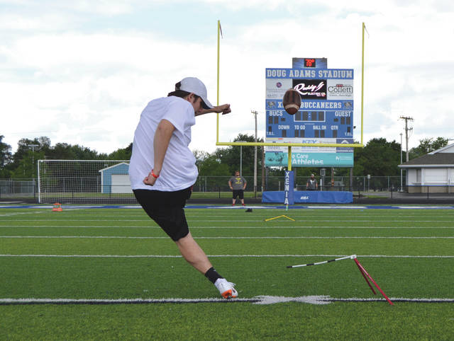 Thomas Mitchell, of Kings High School in Kings Mills, follows through after booming a field goal through the uprights June 23 at Doug Adams Stadium in Xenia.