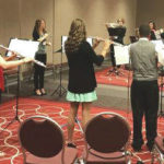 Flute players record composition for publisher