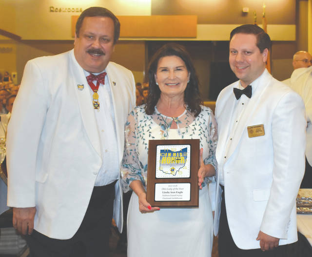Submitted photo Pictured are Ohio State Council Knights of Columbus State Deputy Kevin Miller of Columbus, Linda Ann Wolfe of Fairborn and Council Director Tim Magnam of Xenia at the State Deputy's Banquet Awards Ceremonies at the Northern Kentucky Convention Center in Covington Kentucky.