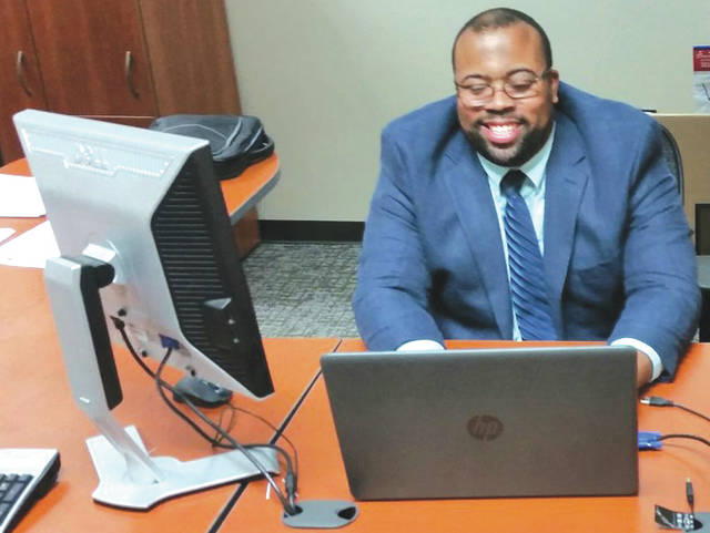 Submitted photo Lamarcus Penn researches Veterans Affairs Benefit changes in his office in Bldg. 2, in Area A. Penn works closely with the military services coordinators located in the VA/Department of Defense office at WPAFB Medical Center.