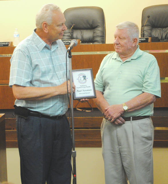 Whitney Vickers | Greene County News Fairborn Mayor Paul Keller presented Fairborn Fourth of July Parade Marshall Paul Newman Sr. with a plaque at the July 16 regular meeting.