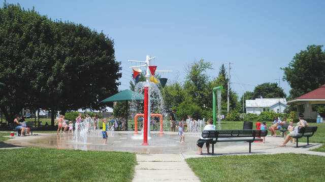 "Whitney Vickers | Greene County News Fairborn's Sprayground and Central Park playground were ""hot"" items July 11 as many young citizens beat the heat and soaked up the fun."