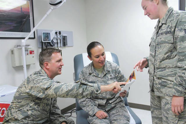 Submitted photo Maj. Justin Fox, 88th Medical Group plastic surgeon, and medical technician Senior Airman Leah Borland, discuss plastic surgery options with Airman 1st Class Brittany Hartsock (middle). The 88th Medical Group plastic surgery clinic's primary mission is to provide reconstructive procedures but recent policy changes have allowed the cosmetic surgery program at Wright Patterson Medical Center to be more accessible.
