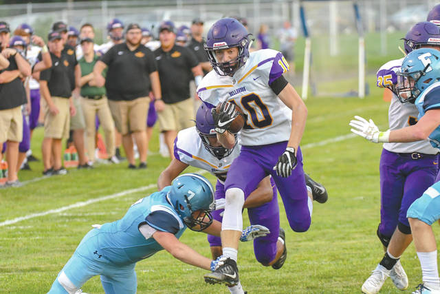Bellbrook sophomore quarterback Alex Westbrock runs for a long gain in the first half of Friday's Aug. 31 high school football game at Fairborn Memorial Stadium.