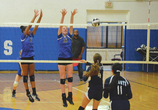 Yellow Springs team members Angelina Smith and Emma Ronnebaum go up to block a shot, during a recent home game with Legacy Christian Academy. Smith and Ronnebaum have both been instrumental in the Bulldogs' 4-0 season opening record.