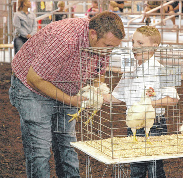 Caleb Johnson answers a question during market chicken judging.