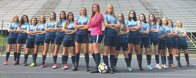 Why do the Fairborn girls soccer players appear so mad? Despite solid play, they've lost their first two matches of the season by scores of 1-0.