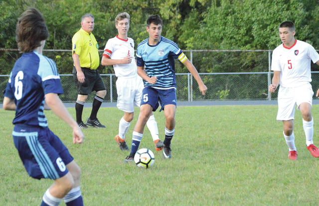 Fairborn's Joe Nickel weaves through a pair of Tippecanoe defenders during the first half of Thursday's Aug. 30 boys high school soccer game at the Fairborn Soccer Stadium. Nickel entered the game ranked fourth in the GWOC with five goals and one assist.