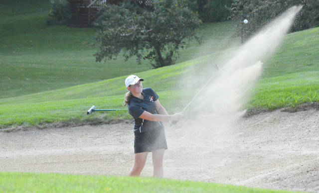 Beavercreek junior Sarah O'Connor blasts out of a sand trap during Wednesday's Aug. 29 girls high school golf team match against Butler on the Beavercreek Golf Club's front nine.