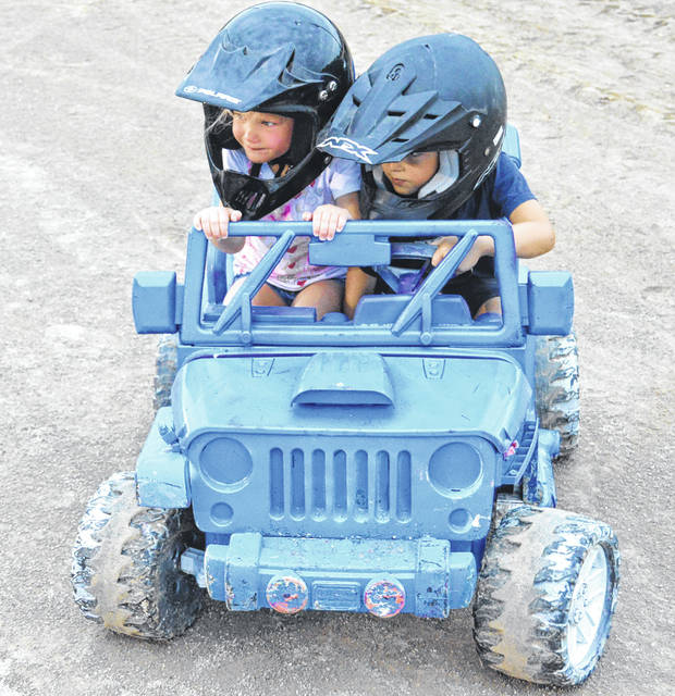 John Bombatch | Greene County News The 2018 Greene County Fair is filled with a variety of entertainment for the family. Connor Ahrman and Lily Ahrman of Xenia participated in the kiddie demo derby July 30.