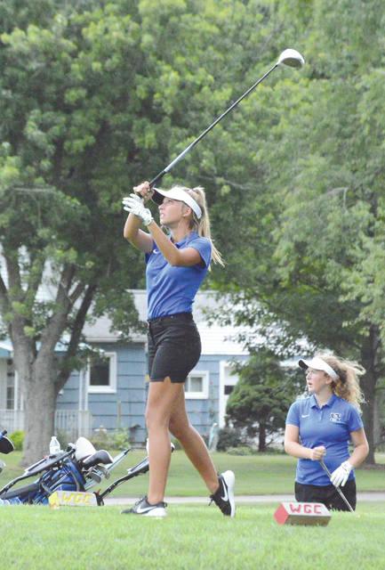 Sophomore Grace Bond follows her tee shot, as Xenia teammate Brynna Mardis looks on, during Wednesday's Sept. 5 girls high school golf team match against Alter at WGC Golf Course in Xenia. The match marked Xenia High's first home match in at least seven years.