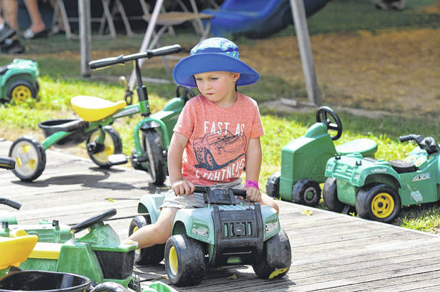 Barb Slone   Greene County News Youngs Jersey Dairy, 6880 Springfield-Xenia Road, hosted a special family day during the holiday weekend. Udders & Putters miniature golf, Cowvin's Fast Slide, Cowvin's Kiddie Corral, Cowvin's Corny Maze and Wagon Ride on the Farm.