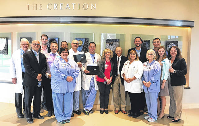 Submitted photo Soin Medical Center & Greene Memorial Hospital CEO Rick Dodds with staff and management at Soin Medical Center after receiving the Center of Excellence award.