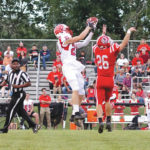 Flags fly in narrow Cedarville loss