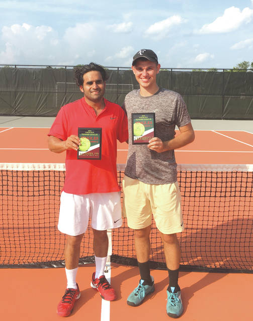Jason Holloway of Xenia (right) poses with Beavercreek's Varun Lethra after the two played in the Fairborn Parks and Recreation Summer Tennis League's Division A tournament final, earlier this month at Fairborn Community Park. Holloway defeated Lethra to claim his second straight Division A title.