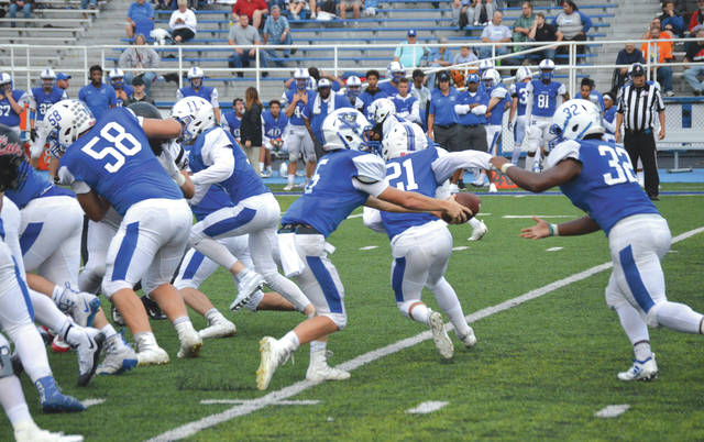 Xenia quarterback Christian Severt (5) hands off to running back Sincere Wells (32) in the first half of Friday's Sept. 7 home game against Franklin. Severt threw for two touchdowns while Wells ran for three others in the Bucs' 35-26 win at Doug Adams Stadium.